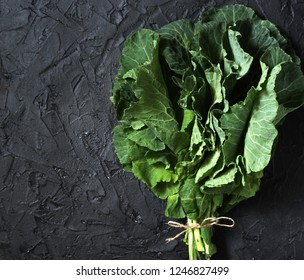 Green Collard bunch of leaves on black background. organic nutrition concept. raw foods kale. Raw Green Organic Collard Greens. square format