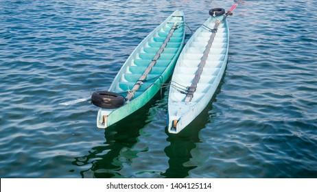 green color dragon boat on the sea