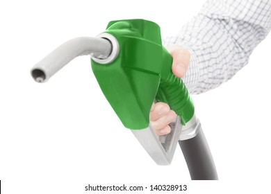 Green color gun from the fuel pump in hand and isolated on white
