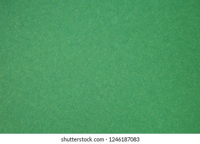 Green Colored Construction Paper. Close up view of Colored Construction Paper. Backgrounds and Textures. Opacity filter used to lighten and grade the image.