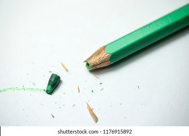 Green colored pencil with broken tip