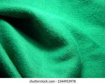 Green colored synthetic wawy stretch fabric. Hosiery