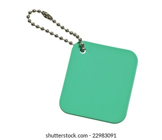 Green colored tag with chain isolated on white background