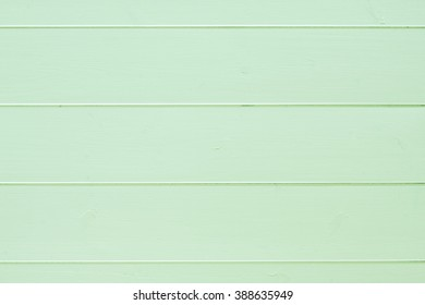Green colored wood plank texture as background
