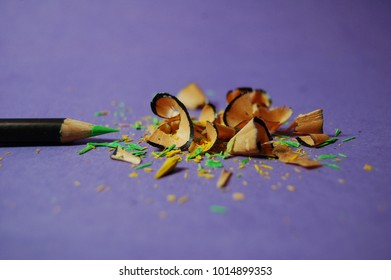 Green coloring pencil by pencil shavings