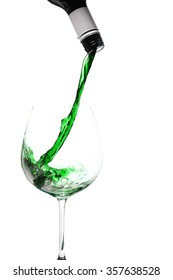green coloured liquid pouring into a wine glass, good image for St Patrick's Day tomfoolery.