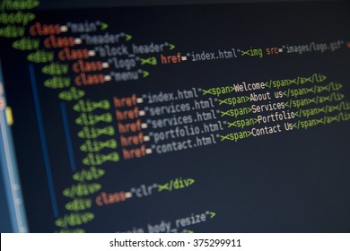 Green computer HTML code in code editor for website development, with SEO concepts for better SERP. search engine optimization for better rankings with PHP, JavaScript and CSS