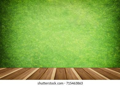 Green Concrete texture backdrop with wooden shelf