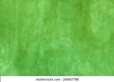 Green concrete wall background.
