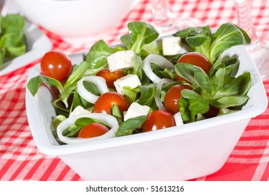 green corn salad with tomatoes and feta cheese