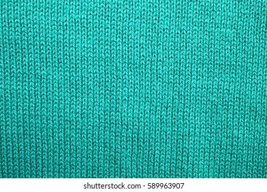 Green cotton fabric texture close up. Background from a natural textile material.