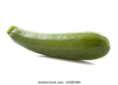 Green courgette laying down isolated over white