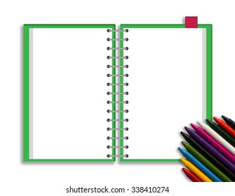 Green cover notebook and crayon