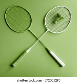 Green creative sport badminton rackets on fashion design greenery background