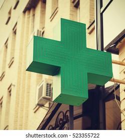 Green Cross. Pharmacy. Green Cross on a building.
