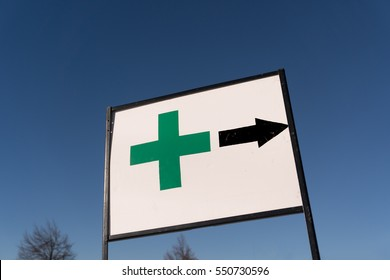 A green cross points the way to a legal marijuana dispensary in Eugene Or. Dispensaries for legal pot will be opening several states after several measures passed.