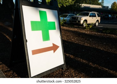 Green Cross Sign Retail Cannabis Portland. Green cross symbol advertising a legal retail cannabis dispensary in Portland, Oregon.