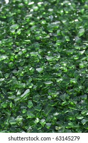 Green crushed glass ready for recycling