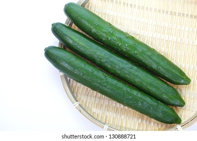 The green cucumbers isolated on white