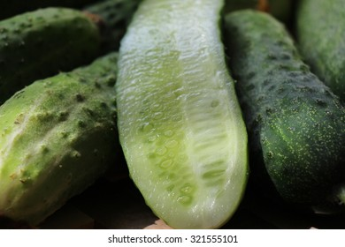 Green cucumbers on the wooden table