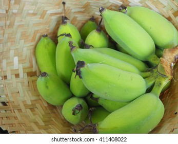 Green Cultivated banana in Bamboo Basket
