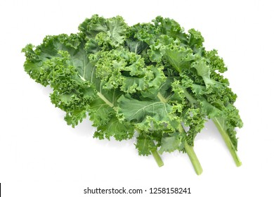 Green curly kale leaves isolated on white background