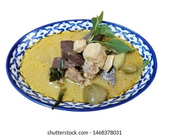 Green Curry Chicken in chili paste soup with coconut milk Thai Food sweet curry dish The best popular of food in Thailand top view. On white background. With clipping path.