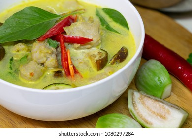 Green curry with fish balls Thai food in white bowl / Select focus