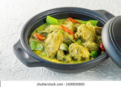 Green curry, Thai food very popular Thai street food is green curry chicken ingredient with Sliced chicken creamy coconut milk soup in Green Curry Paste. Sprinkle with basil leaves.