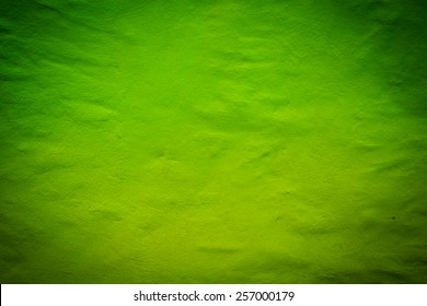 Green dark texture background with bright center spotlight