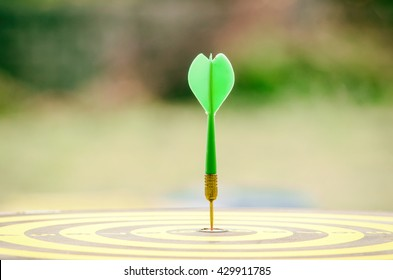 Green dart with target arrows  ,business concept of target marketing. Success or Goal symbol.