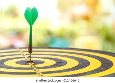 Green dart with target arrows ,business concept of target marketing