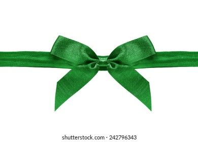 Green decorative bow on a ribbon on white background