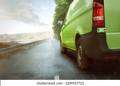 Green delivery van driving through nature