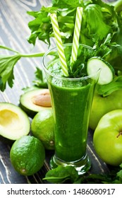 Green detox smoothie with avocado, cucumber, spinach and  fresh greens. Healthy eating, weight loss and dieting concept, selective focus with  shallow depth of field