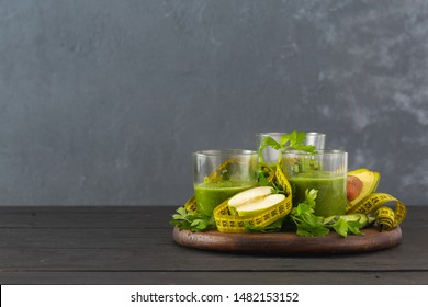 Green detox smoothie with measuring tape detox diet concept