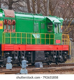 Green diesel cargo locomotive. Freight train in action