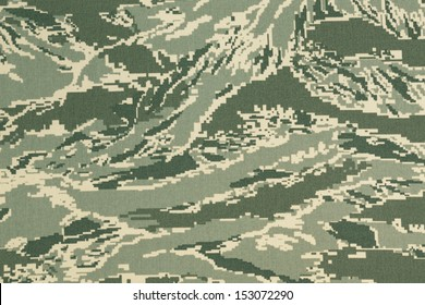 Green digital tigerstripe camouflage fabric texture background