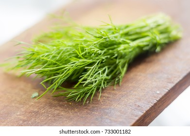 green dill on cutting desk soft focus
