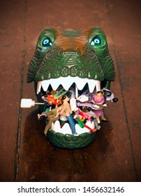 green dinosaur head eating people on a old wooden floor