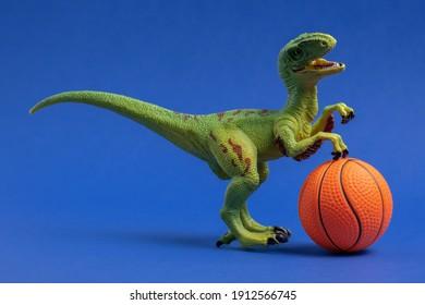 Green dinosaur toy with basketball ball. Basketball minimal card blue background.