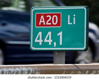 Green distance sign at 44,1 km the place where the traffic jam on motorway A20 at nieuwerkerk aan den IJssel as daily rush hour congestion starts