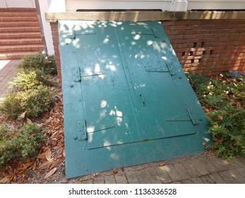green door to basement or cellar