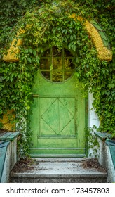 Green Door Of Fairytale Cottage With Round Window