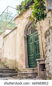 Green door in Herceg Novi
