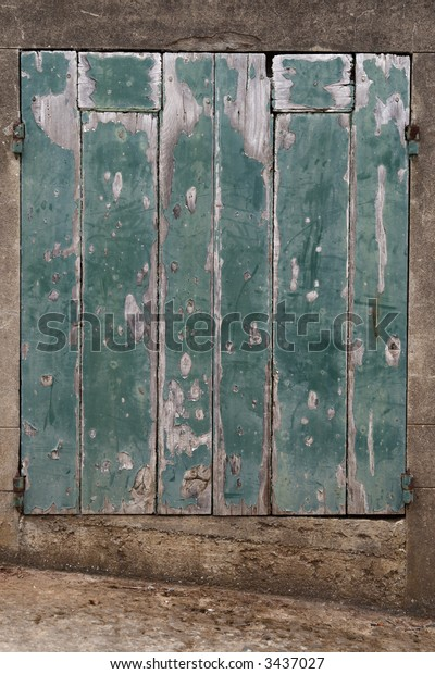 Green door made of old, weathered wood