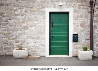 Green door in old stone house, Croatia