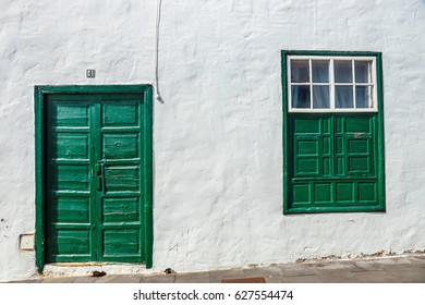 green door and window on white wall background