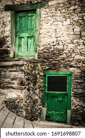 Green doors in an old mountain village.