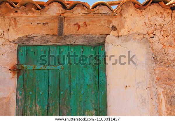 green doors and textures